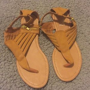 Tan sandals with zipper details